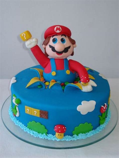 Round Blue Cake With Super Mario Poppping Out 2 Comments