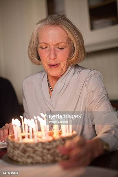 Old Woman Blowing Out Candles Photos and Premium High Res ...