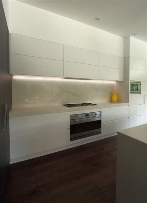 kitchen with overhead lift up cupboards led lights