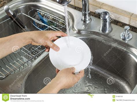 kitchen faucet prices washing dinner plate in kitchen sink stock