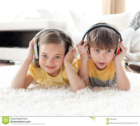 Cute Brother And Sister Listening Music Stock Image