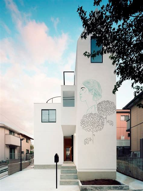 japanese house facade maria umievskaya adds ancient drawings to modern japanese homes