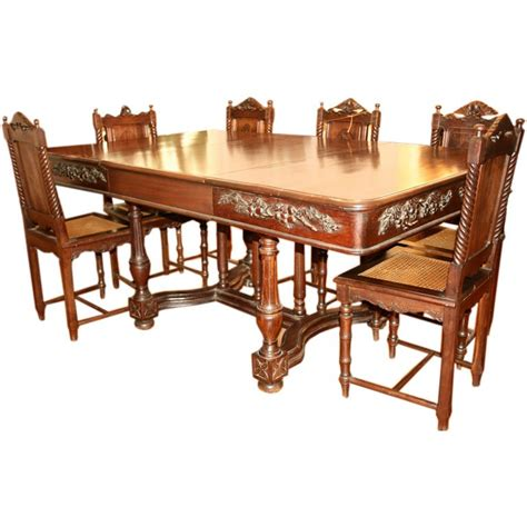 carved rosewood dining table with six chairs at 1stdibs