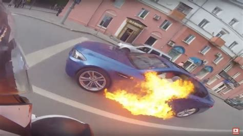 video bmw  catches fire driver unexpectedly