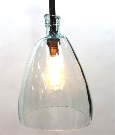 large clear glass bottle pendant light with black pipe