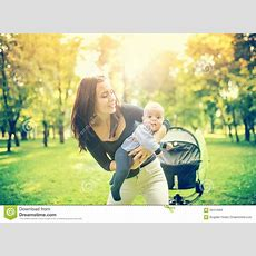 Happy Mother Holding And Playing With Newborn Son Happy