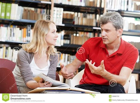 young adult people reading book  library stock image