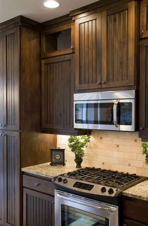 The turquoise blue cabinetry in this cheerful kitchen is the perfect foil for a terrazzo backsplash that gives the room a fun and energetic vibe. We need to decide! | Brown kitchen cabinets, Backsplash ...