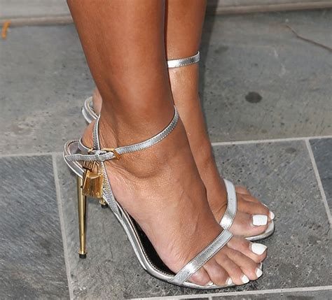 gold silver clutch mel b shows toned figure in lbd and tom ford heels at