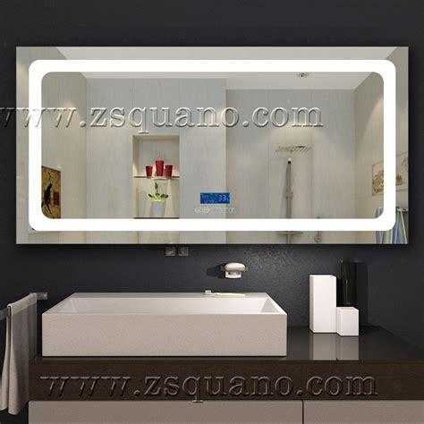 length bathroom wall mirror with light illuminated