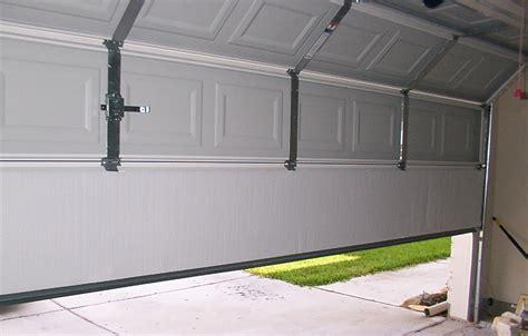 how to fix garage door panel replace or repair your garage door panel doormatic