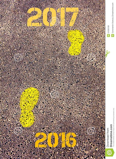 Yellow Footsteps On Sidewalk From Year 2016 To Year 2017