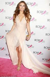 Elizabeth Hurley looking gorgeous in a plunging nude gown ...