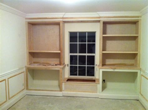 cabinets upper bookcases flanking window seat