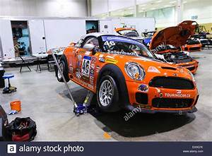Mini Cooper Race Car Jacked Up For Repair Stock Photo