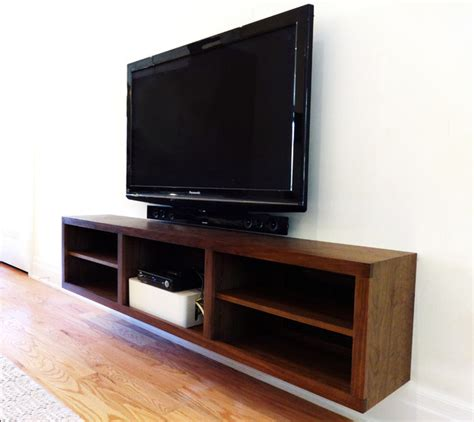 walnut entrance cabinet and floating t v console modern