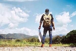 Young Man Traveler with backpack relaxing outdoor Photo Free Download