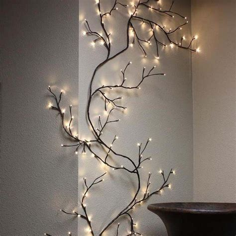 """Get inspired by our thousands of wall mural works with amazing designs, or create your own! Birch Branches 96 LEDs 40""""   Branch decor, Tree branch decor, Decor"""
