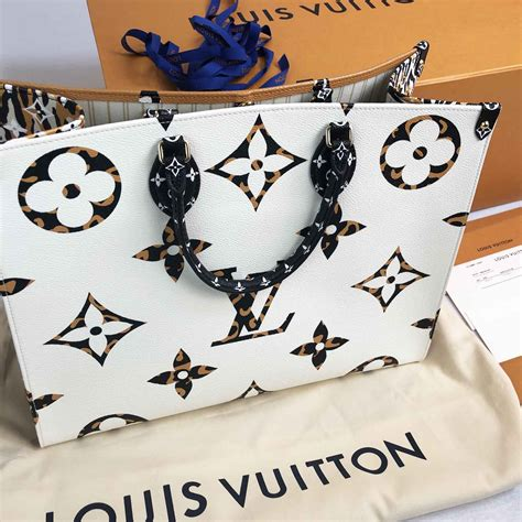 louis vuitton jungle print    onthego bag white  orange handbagholic