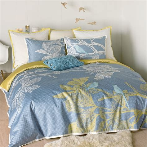 simple small bedroom design with light yellow blue twin