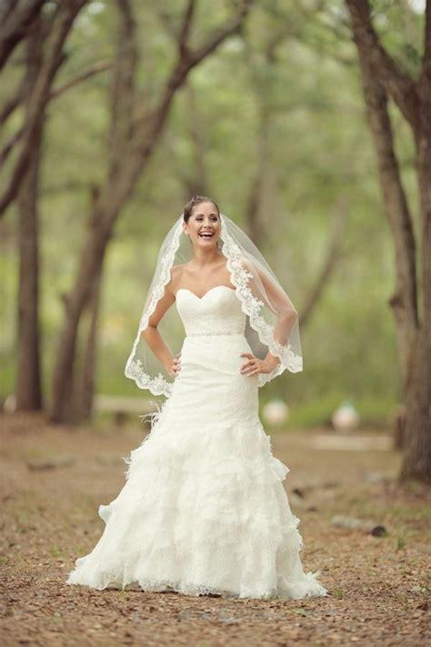shabby chic wedding dress ideas bridal portraits ruffled lace allure wedding dress gorgeous lace veil aqua mint and pink