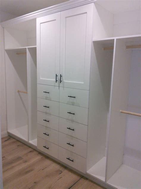walk in closet with custom white cabinets martin cabinet
