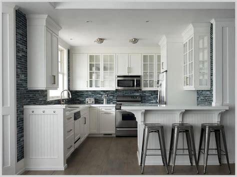 white beadboard cabinets  honed black countertops