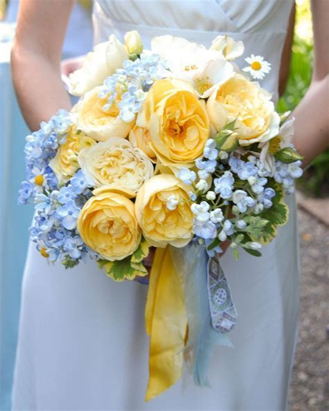 yellow bouquet flowers   blue and green