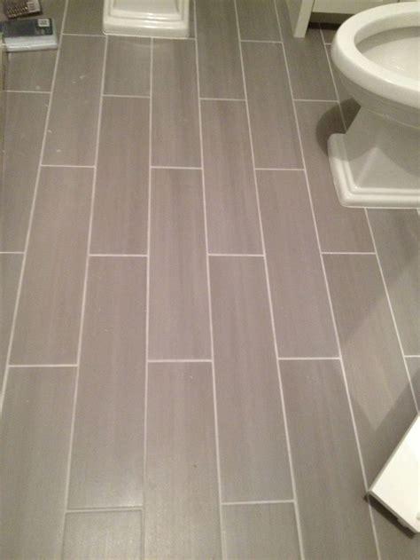 guest bath plank style floor tiles  gray sarah