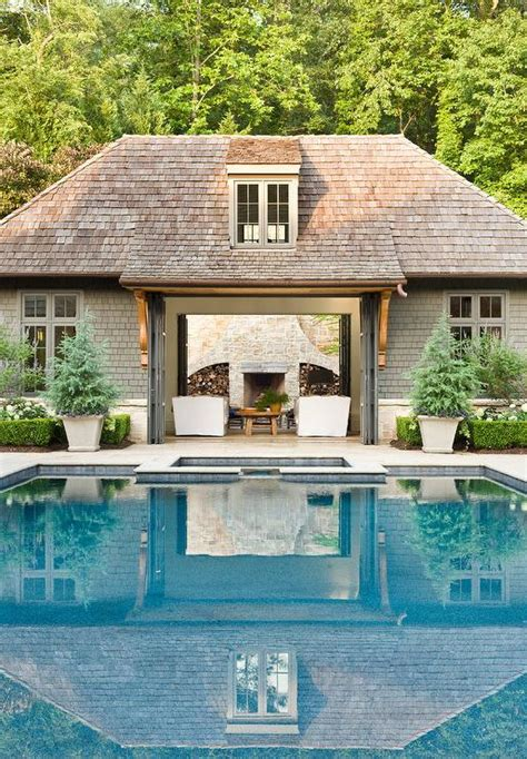 pool house  folding glass doors traditional pool