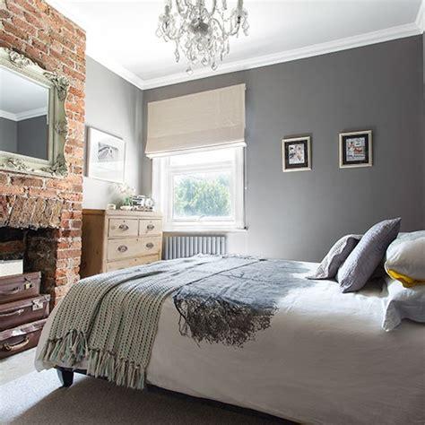 grey bedroom  exposed brick wall decorating