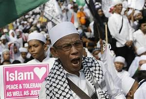 Indonesia hard-liners call for jailing of Christian ...
