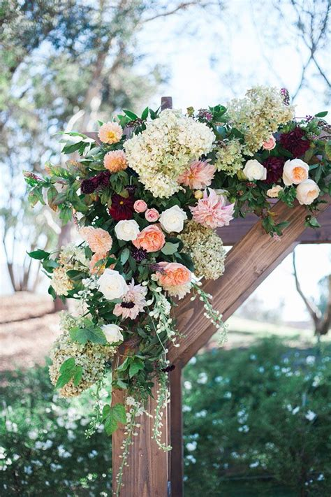This Rustic Wooden Wedding Arch With Colorful Flowers Is