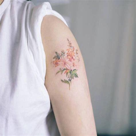 illustrative style flower tattoo   left upper arm
