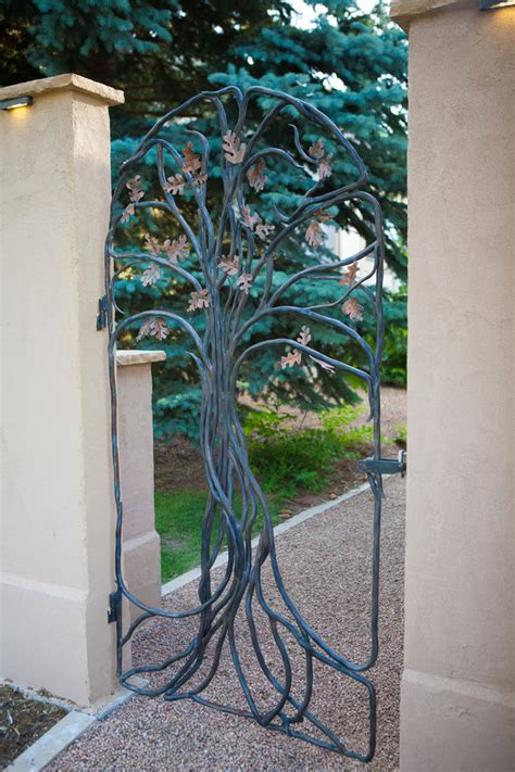 tree of life landscape traditional with stucco wall iron