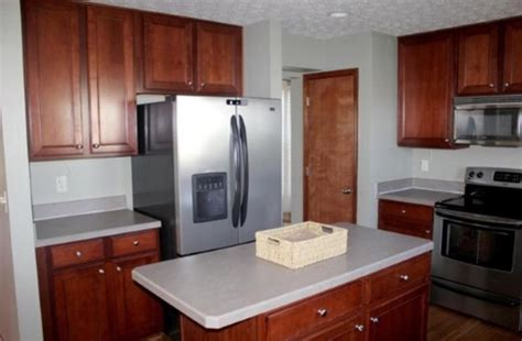 cherry cabinets with gray countertops quartz countertop color to pair with cherry ish cabinets