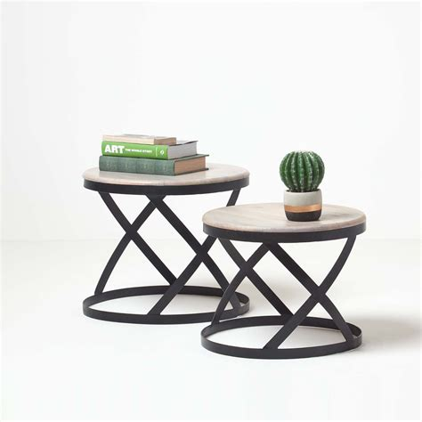 This table top was made from the cross sections of salvaged wine barrels. Soho Round Barrel Nesting Tables, Grey