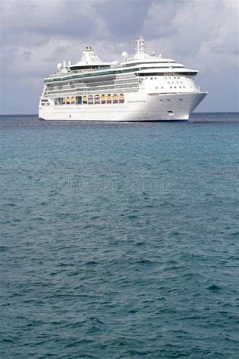 big cruise ship  small boat stock photo image