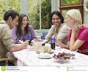 Young People Sitting At Verandah Table Stock Image - Image ...