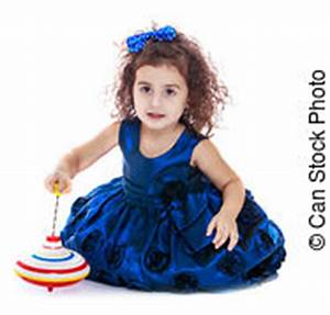 cute little girl spinning dreidel stock photos and images With curly spinning on floor