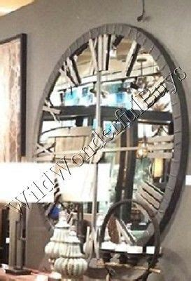 mirrored wall clock   mirror roman numeral
