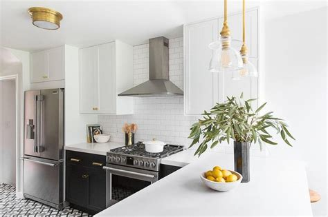 black  cabinets  brass cup pulls transitional