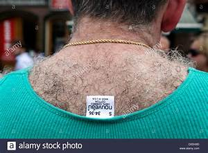 Very Hairy Back Of Male Person With Clothing Label