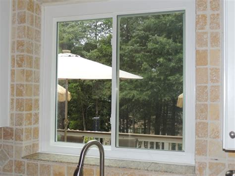double sliding window replaced  casement window   kitchen sink  slider