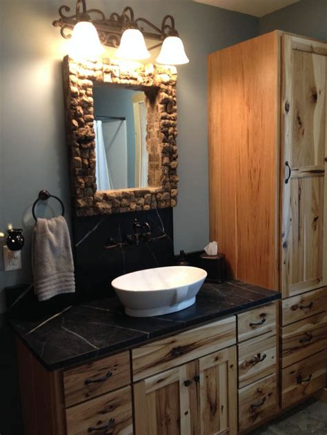 rustic modern bathroom lava rock mirror hickory cabinets