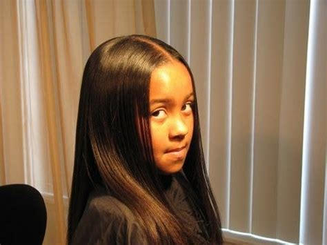 Flat Iron Hairstyles For by Thermal Relaxing A Child S Hair With A Feather Flat Iron