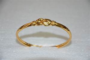 Gold plated hand design bangle bracelet with rhodium ...