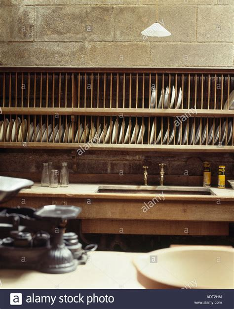 large wooden plate rack  wall  sink  victorian kitchen stock photo alamy