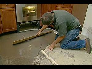 How to level a concrete floor this old house youtube for How to level floors in a house