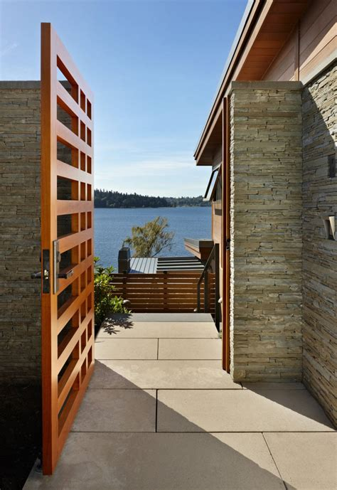 contemporary house gates grand glass lake house with bold steel frame modern house designs